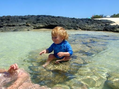 Danny on rock in sea